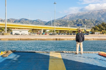 Person standing on a lowered ramp of a ferry