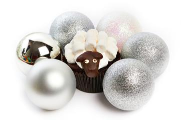 Cupcake lamb with silver Christmas balls as simbol 2015 new year