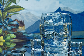 Tropical Background with Glass of Water/Ice Cubes
