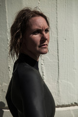 Attractive serious looking female swimmer wearing wetsuit