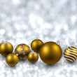Silver background with golden christmas balls.