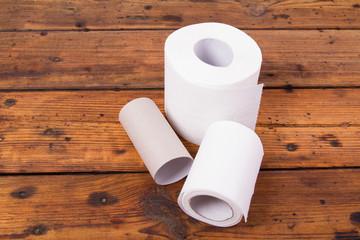Toilet paper on a wooden floor