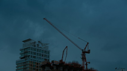 Time-lapse of clouds moving pass construction site