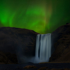 The aurora over Skogafoss of Iceland