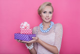 Fototapety young beautiful woman with pink and purple gift boxes