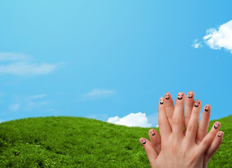 Cheerful finger smileys with landscape scenery at the background