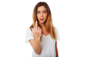 Young woman giving a rude gesture