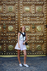 Attractive teenager girl having fun smiling standing outdoors