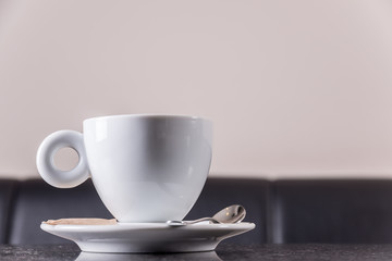 Cup of coffee at the table in the coffee shop.