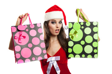 Girl with Christmas shopping in the hat of Santa Claus