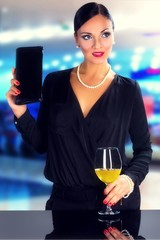 Attractive black hair woman drinking white wine in night club.