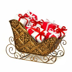 Christmas sleigh filled with red and white gift boxes