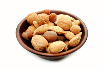 Mixed Whole Nuts in a Wooden Bowl Over White