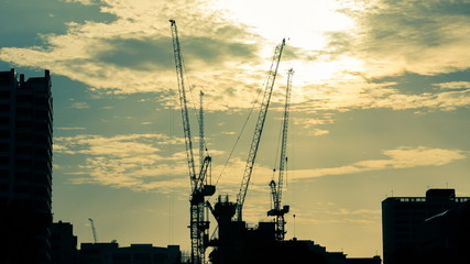 Time lapse of Silhouettes construction cranes