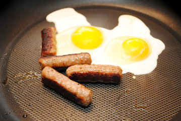 Cooking Two Sunny Side Up Eggs with Sausage