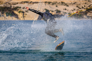Wakeskater in a cable park doing tricks