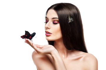 Beautiful young girl with a butterfly