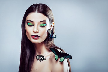 Beautiful young girl with a butterflies
