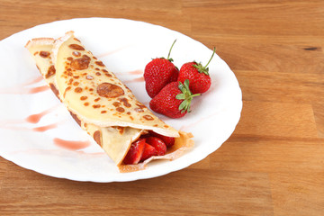 strawberry pancakes on white plate on the table