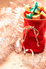 2015 New Year. Santa Claus sack of presents on silver background