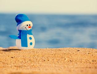 Snowman on sand