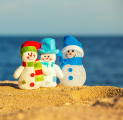 Snowmans on sand