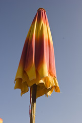 Red and yellow close beach umbrella