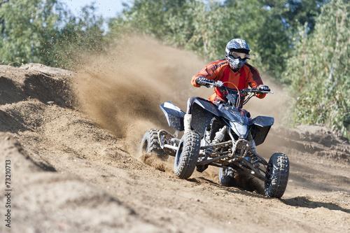Aluminium Motorsport Rider driving in the quadbike race