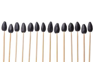 sunflower seeds impaled on toothpicks