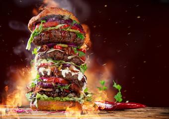 Big burger on dark background