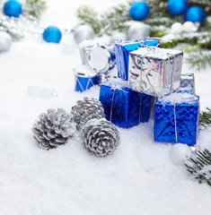 Blue chrismas  gifts box on snow