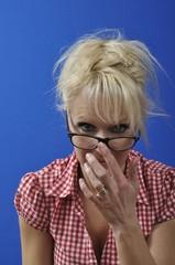 Portrait of a blonde woman wearing glasses