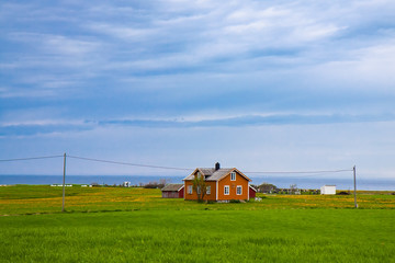 Norwegian traditional alone house in countryside