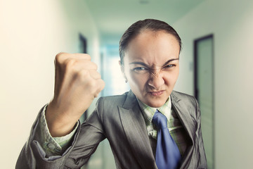 Angry irritated woman in the office