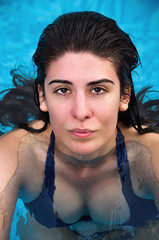 Close-up of a young woman in the swimming pool