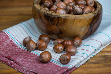 bowl with hazelnuts on kitchen cloth