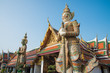 The two giant statue in Wat Pra Kaew, The Grand Palace, blue sky