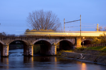 Incoming train on the stony railway bridge