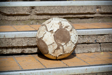 old soccer ball in the street