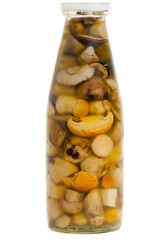 pickled mushrooms in a glass bottle