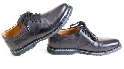 couple of men's black leather shoes