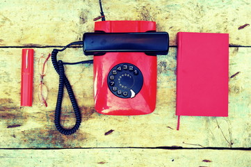Retro rotary telephone on a wooden background