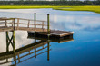 Boat Dock reflecting in inlet marsh water - 73216907