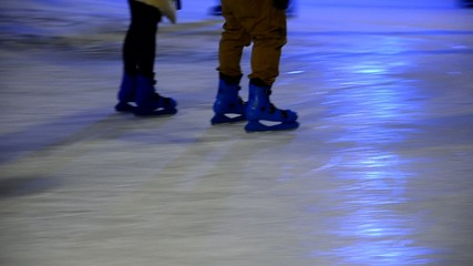 crowd of Ice skaters at a public ice skating rink