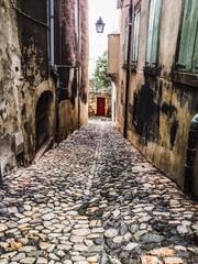 medieval cobblestone streets in Le Puy en Vilay in France