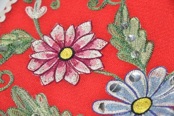 red material with flowers embroidery