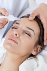Relaxed woman during cavitation peeling