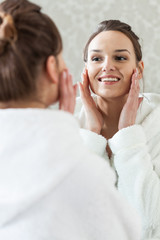 Woman after facial treatment