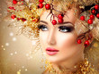 Christmas winter fashion model girl with golden hairstyle