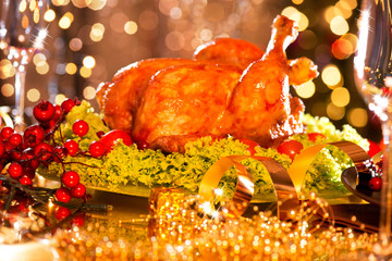Christmas table setting with roasted turkey